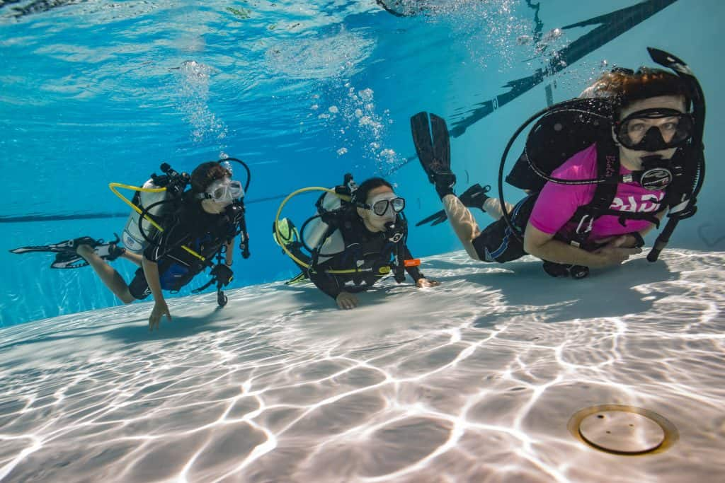Kids diving with instructor Malapascua pool